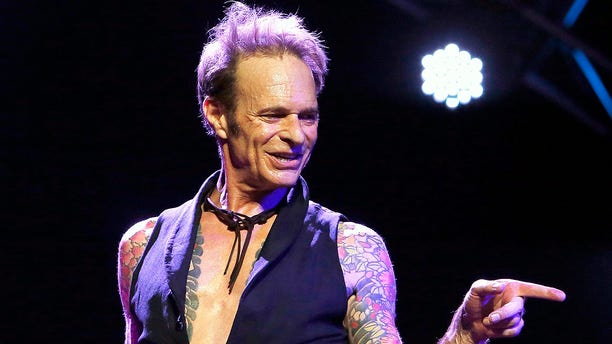 Van Halen vocalist David Lee Roth performing at Ak-Chin Pavillion in Phoenix, Ariz.