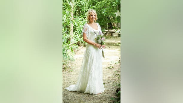 """""""It was the first designer dress I tried and as soon as I put it on I just loved it,"""" bride Emma Male saidof choosing the dress, which she purchased at a sample sale at her friend's boutique. She wore it at her 2016 wedding."""