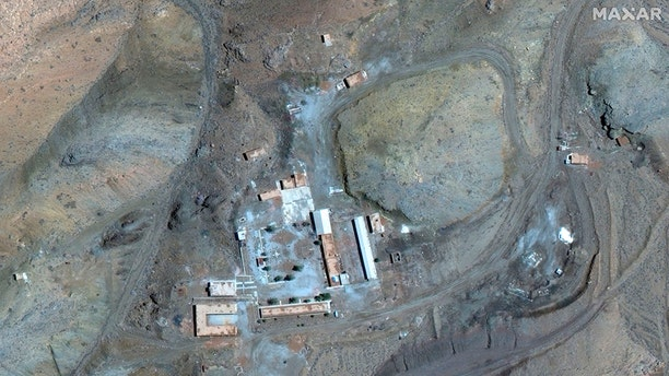 A March 27 satellite image of the Iranian site provided by Maxar Technologies shows a compound with a series of buildings surrounding a courtyard, with other smaller structures away from it.