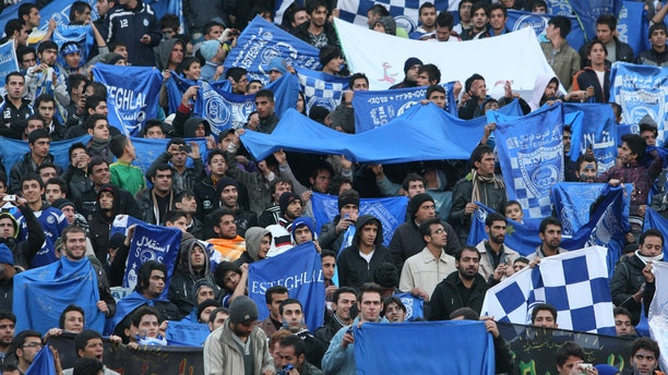 """Sahar Khodayari, an Iranian female soccer fan known as """"Blue Girl"""" for the colors supporting of the Esteghlal team, died after setting herself on fire after learning she may serve a six-month prison sentence for trying to enter a soccer stadium where women are banned, a semi-official news agency reported Tuesday."""