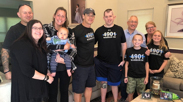 Cem Duzel and his family with John Cena (center with hat)