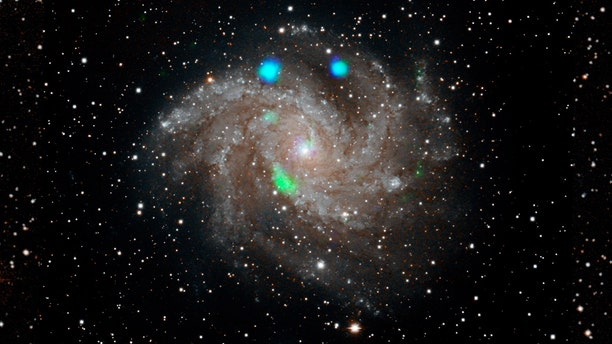 This visible-light image of the Fireworks galaxy (NGC 6946) comes from the Digital Sky Survey, and is overlaid with data from NASA's NuSTAR observatory (in blue and green). Credit: NASA/JPL-Caltech