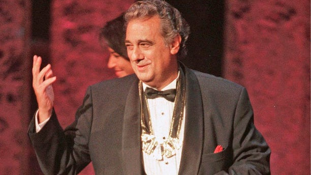 Placido Domingo acknowledges the audience after receiving the 1999 Hispanic Heritage Award at the John F. Kennedy Center for the Performing Arts in Washington.