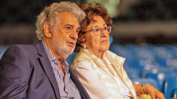 In this Tuesday, Aug. 27, 2019 file photo, Placido Domingo and his wife, Marta, attend a rehearsal for the opening gala of the Gerard of Sagredo Youth Forum and Sports Center in Szeged, Hungary.