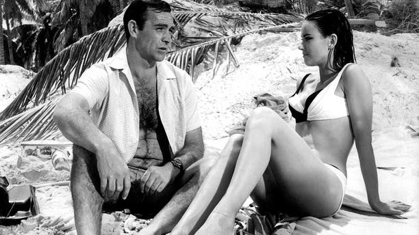 """Sean Connery, as James Bond, with """"Thunderball"""" co-star Claudine Auger, asDominique """"Domino"""" Derval in an undated photo from 1965."""
