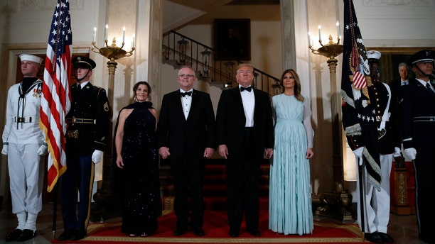 President Donald Trump and first lady Melania Trump stand with Australian Prime Minister Scott Morrison and his wife Jenny Morrison in the Grand Foyer of the White House. (AP Photo/Alex Brandon)