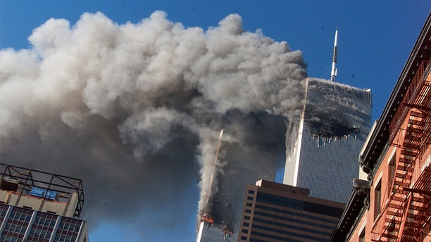 Smoke rises from the burning twin towers of the World Trade Center after hijacked planes crashed into the towers in New York City on Sept. 11, 2001. (AP)