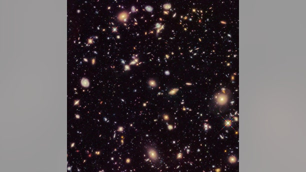 This image made available by the European Space agency shows galaxies in the Hubble Ultra Deep Field 2012, an improved version of the Hubble Ultra Deep Field image. A study published Sept. 12, 2019, uses a new technique to come up with a rate that the universe is expanding that is nearly 18 percent higher than the number scientists had been using since the year 2000. (Credit: NASA, ESA, R. Ellis (Caltech), HUDF 2012 Team via AP)