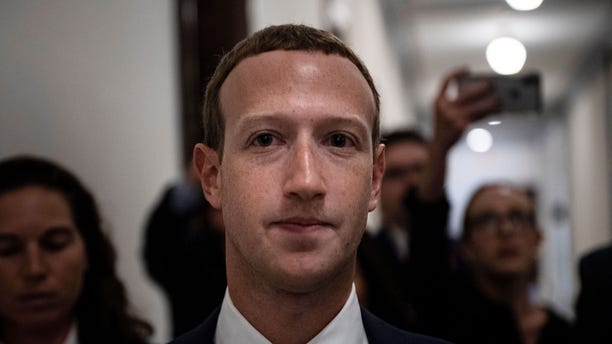 Zuckerberg walks to meetings for technology regulations and social media issues on Sept. 19, 2019, in Capitol Hill, Washington, D.C.