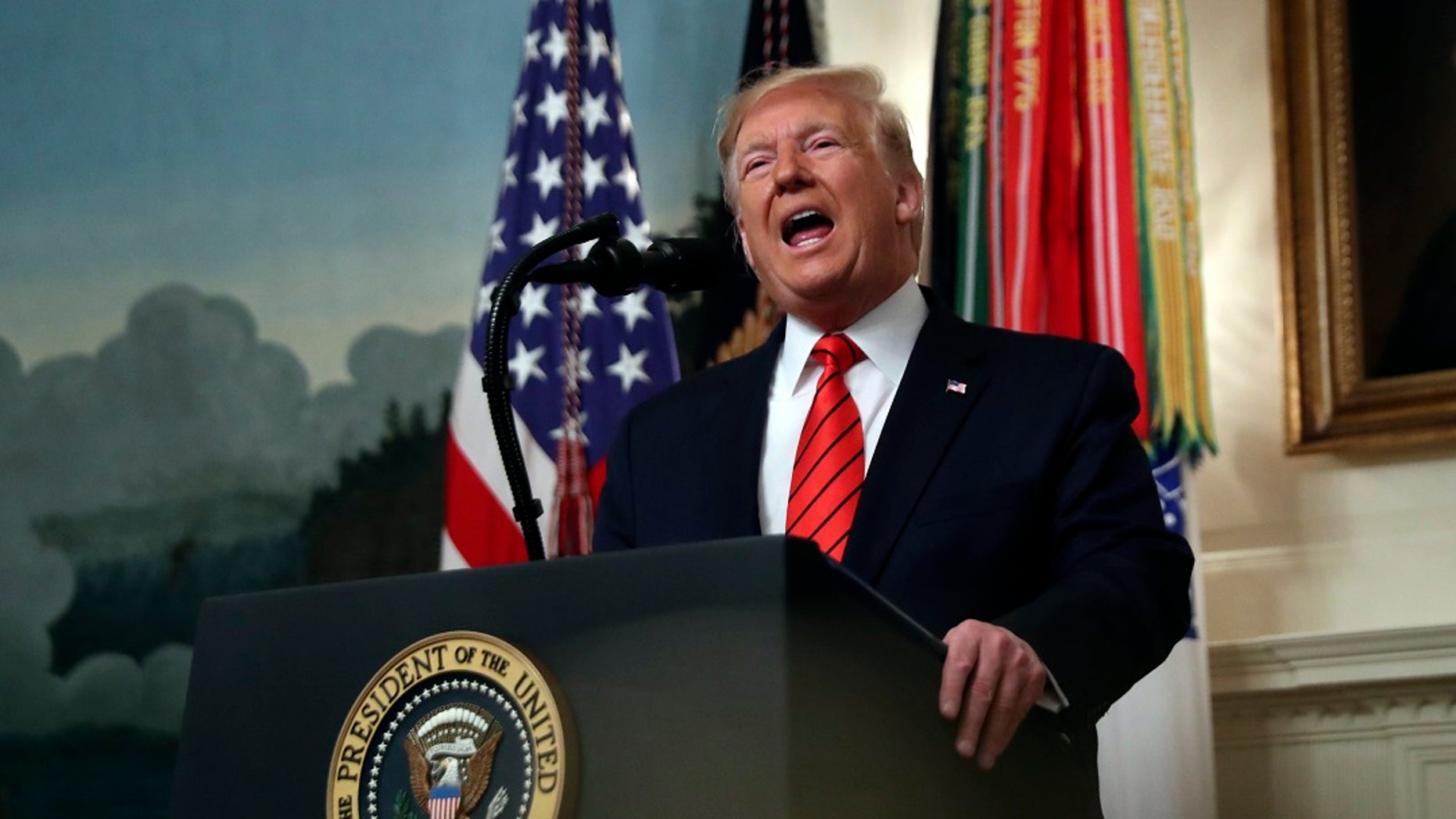 President Donald Trump told the Washington Examiner he may read aloud the transcript from his phone call with Ukrainian President Volodymyr Zelensky on Television, similar to a fireside chat. (AP Photo/Andrew Harnik)
