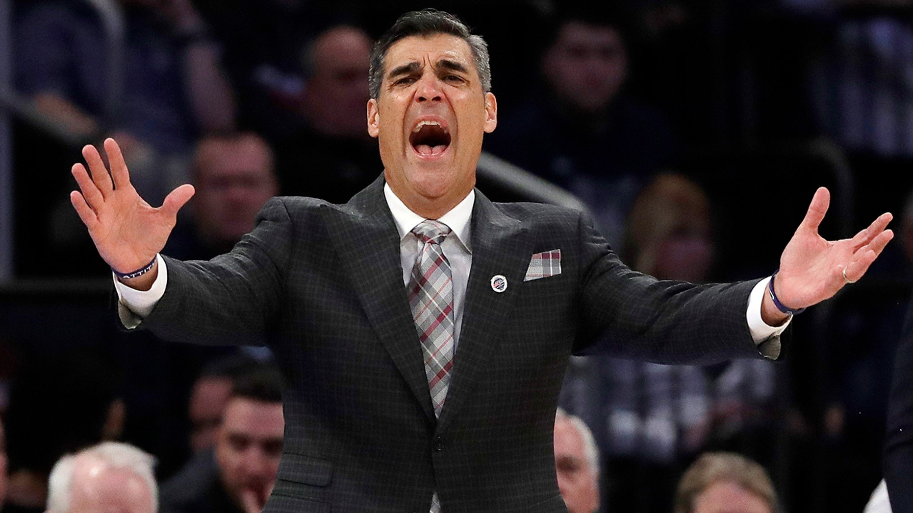 FILE - In this March 14, 2019, file photo, Villanova head coach Jay Wright reacts during the first half of an NCAA college basketball game against Providence at the Big East Conference tournament in New York. Wright is starting his 19th season at Villanova, where he is already the winningest coach in program history. (AP Photo/Frank Franklin II, File)