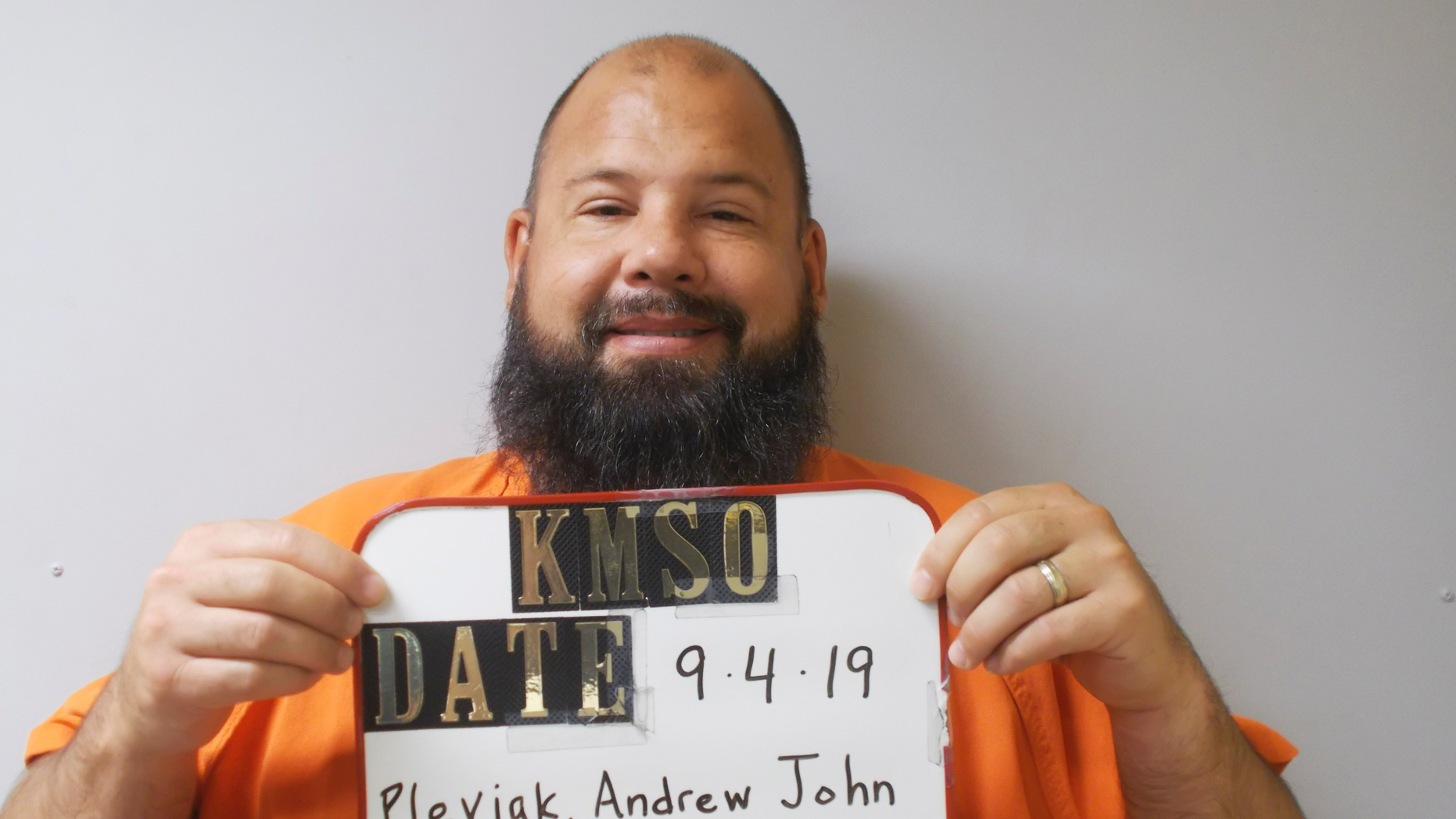 FILE -This Sept. 4, 2019 booking photo provided by the Kingman County Sheriff's Office shows Andrew John Pleviak.   The former agent with U.S. Immigration and Customs Enforcement has pleaded guilty to helping an inmate try to escape from a Kansas jail by impersonating an immigration officer. Pleviak pleaded guilty Wednesday, Oct. 16,  in Kingman County District Court to making false information and attempted aiding of escape. He's also charged in federal court with false impersonation of a federal officer. (Kingman County Sheriff's Office via AP)