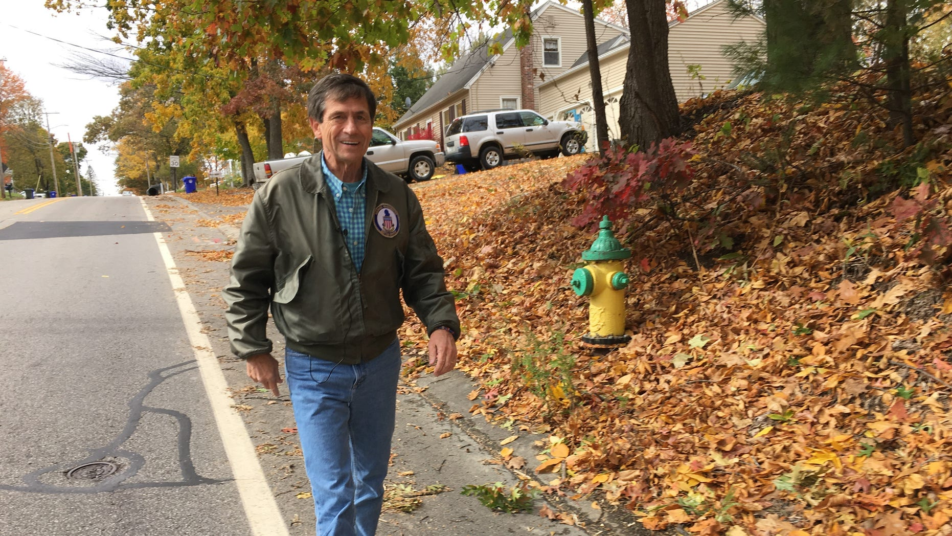 Retired admiral and former congressman Joe Sestak of Pennsylvania - a very long-shot contender for the Democratic presidential nomination, walks across the width of New Hampshire, in Manchester, NH on Oct. 18, 2019