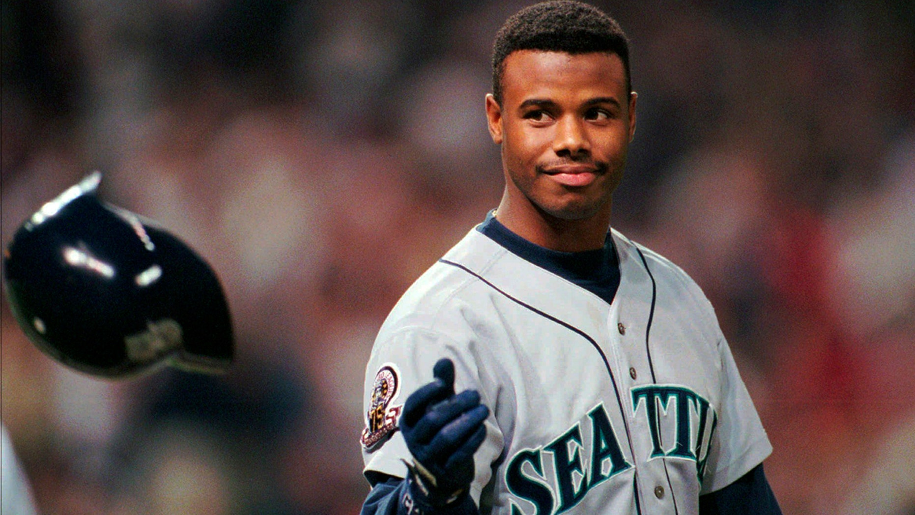 FILE - In this Oct. 13, 1995, file photo, Seattle Mariners Ken Griffey Jr. tosses his batting helmet after grounding out in the eighth inning against the Cleveland Indians in an ALCS game in Cleveland. The Seattle Mariners are the only baseball franchise never to advance to the Fall Classic. Baseball has never been played in Seattle beyond Oct. 22. The Mariners have three times been to the American League Championship Series, and all three times were sent home before there could ever be a Game 7. (AP Photo/Mark Duncan, File)