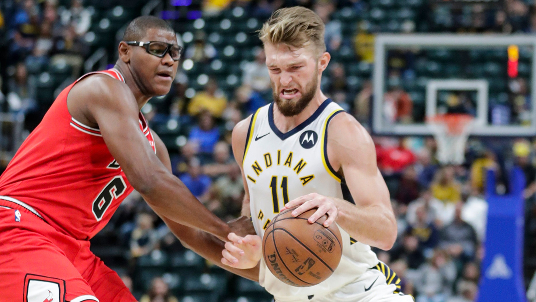 Indiana Pacers forward Domantas Sabonis (11) drives on Chicago Bulls forward Cristiano Felicio (6) during the first half of an NBA preseason basketball game in Indianapolis, Friday, Oct. 11, 2019. (AP Photo/Michael Conroy)