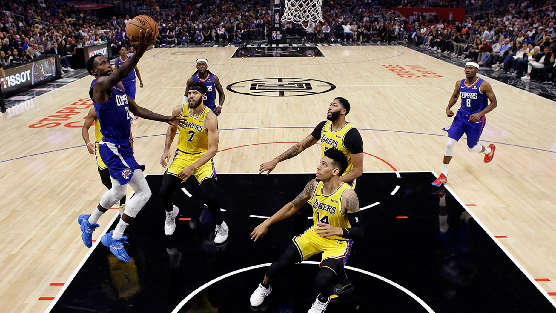 Los Angeles Clippers' Patrick Beverley, left, drives to the basket against the Los Angeles Lakers during the first half of an NBA basketball game Tuesday, Oct. 22, 2019, in Los Angeles. (AP Photo/Marcio Jose Sanchez)