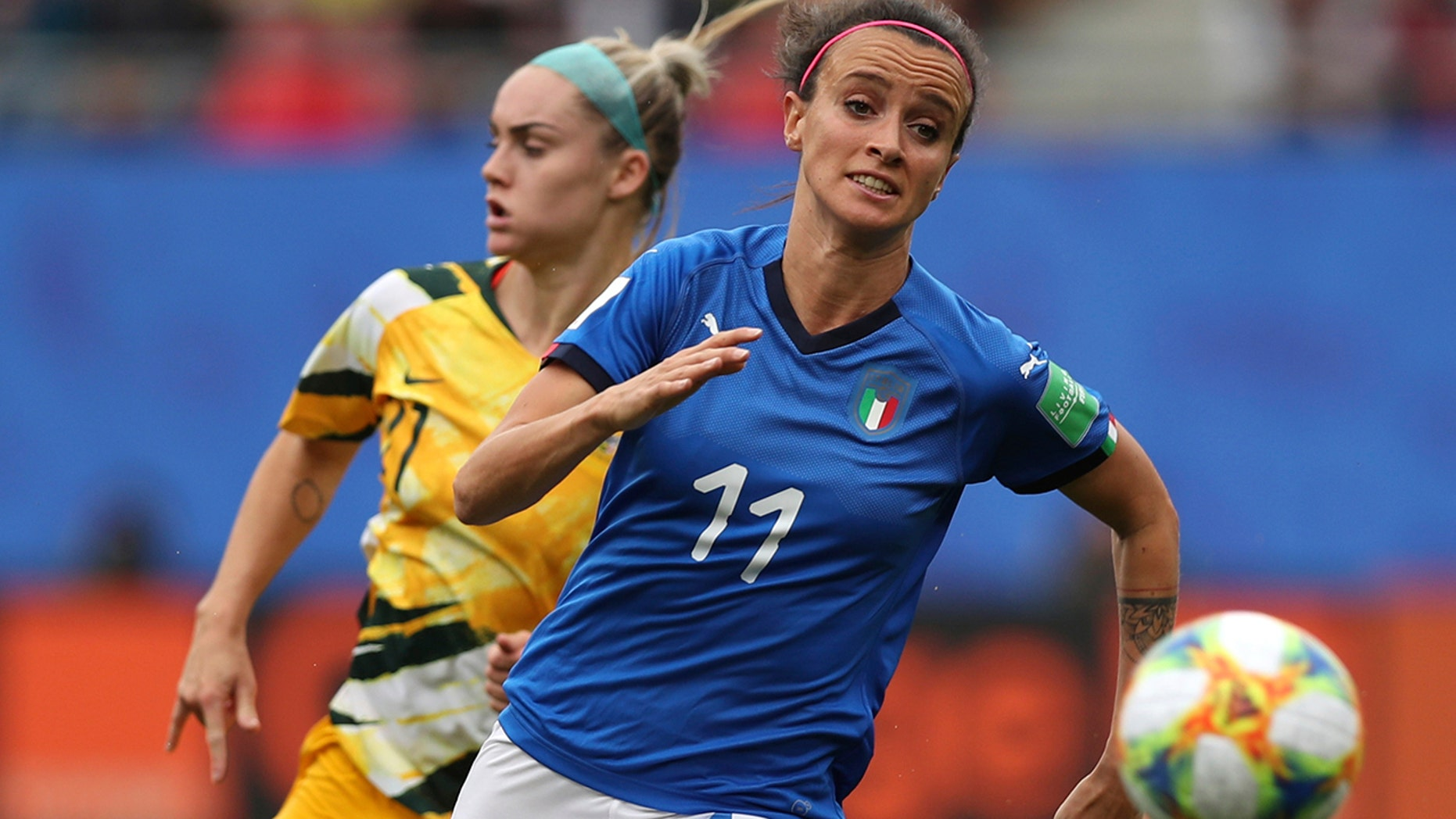 FILE - In this June 9, 2019 file photo, Australia's Ellie Carpenter, left, chases Italy's Barbara Bonansea during a Women's World Cup Group C soccer match between Australia and Italy at the Stade du Hainaut in Valenciennes, France. Italy won 2-0. Italy's surprise run to the quarterfinals of the Women's World Cup this year went a long way toward changing misconceptions about the female game in a country where the most popular sport is dominated by men. (AP Photo/Francisco Seco, file)