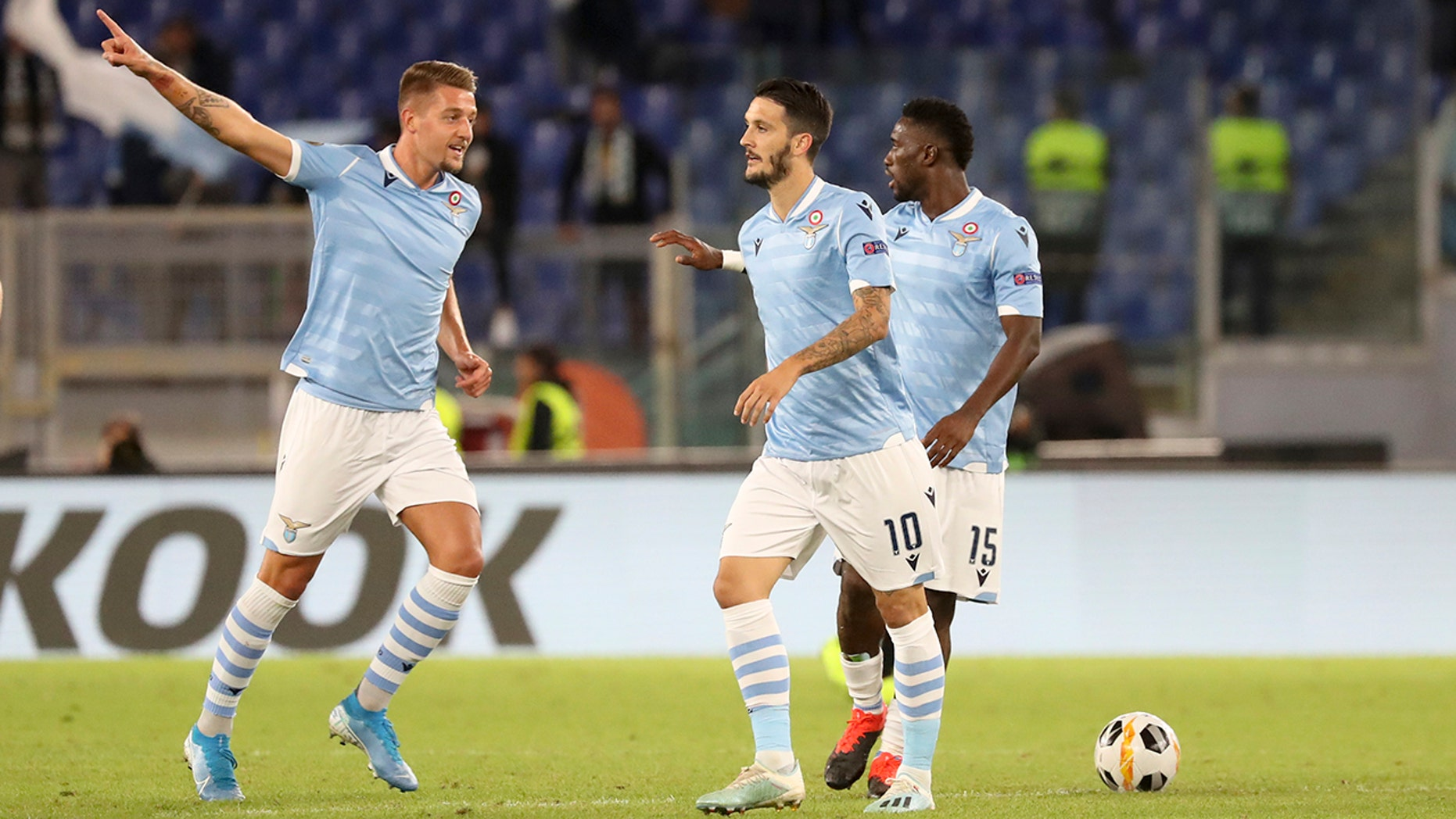 Lazio's Sergej Milinkovic-Savic, left, celebrates after scoring his side's first goal during the Europa League Group E soccer match between Lazio and Rennes, at Rome's Olympic Stadium, Thursday, Oct. 3, 2019. (AP Photo/Alessandra Tarantino)
