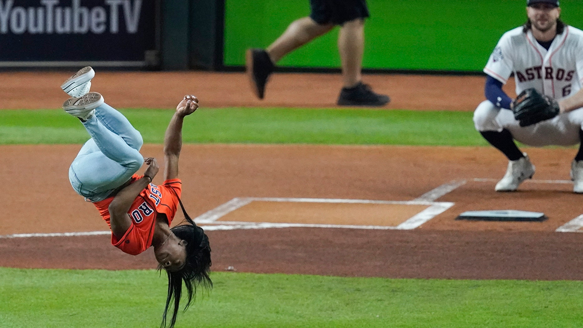 Simone Biles back flip twists before first pitch of the World Series