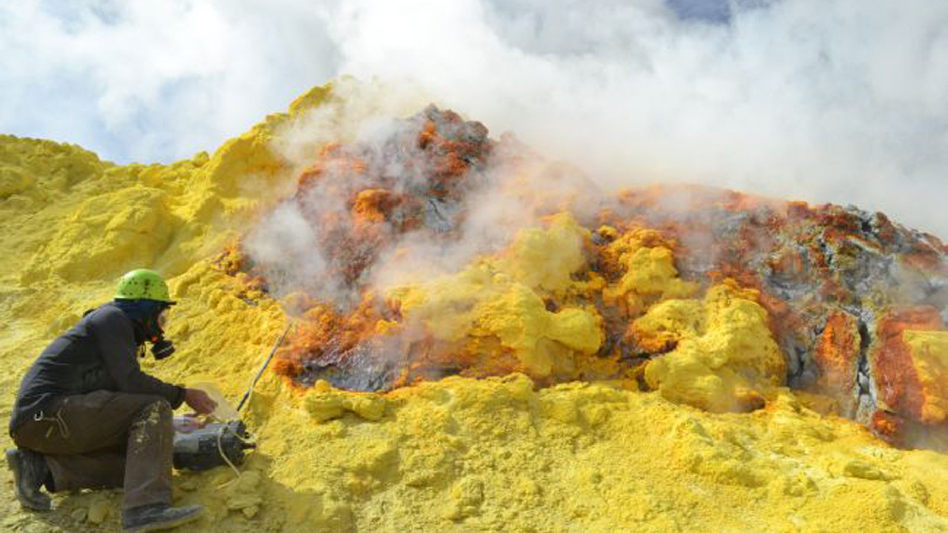 A researcher samples gas emissions released by Lastarria volcano on the border of Chile and Argentina. New research suggests that humans emit about 80 times more CO2 a year than every volcano on Earth combined. (Credit: Yves Moussallam, Lamont Doherty Earth Observatory)