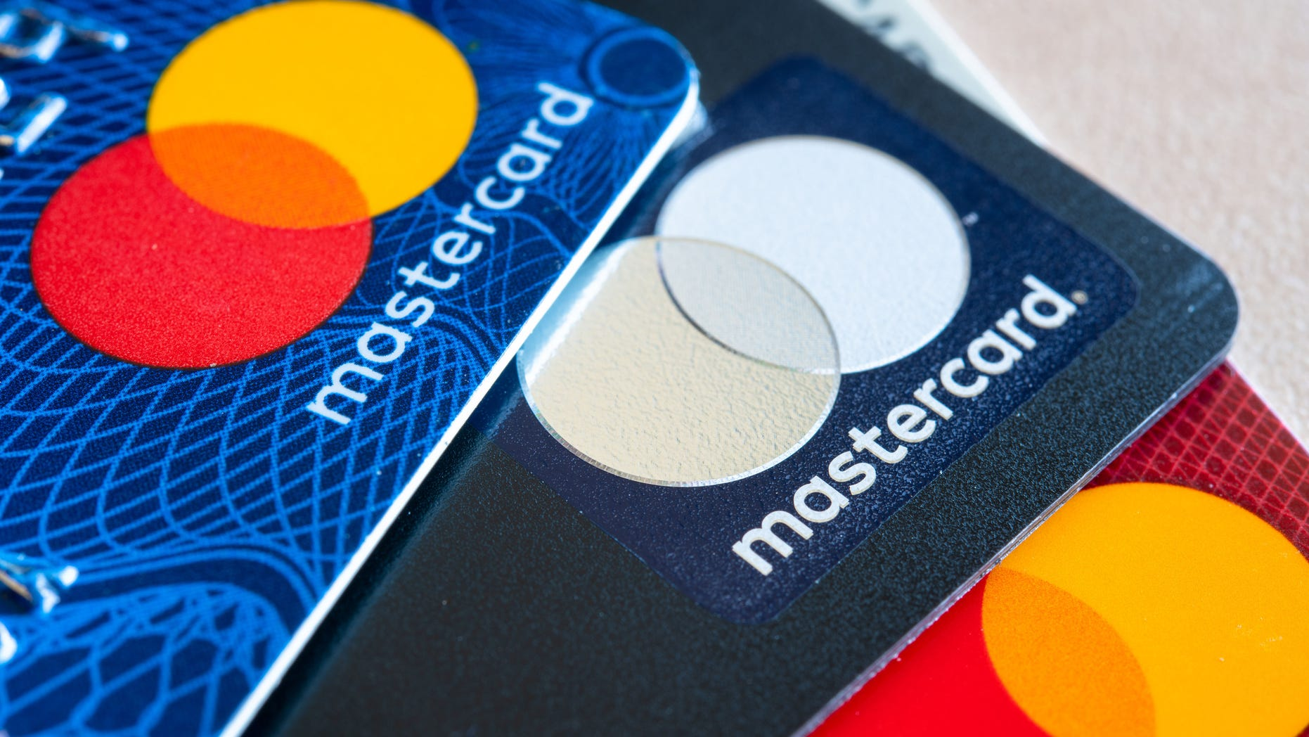 Kim Komando explains the five ways that criminals are coming after your credit cards. In this photo illustration there are three Mastercard Credit Cards. (Photo Illustration by Roberto Machado Noa/LightRocket via Getty Images)
