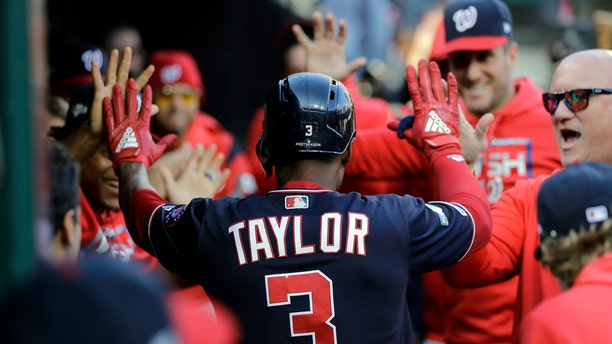 Michael A. Taylor is congratulated in the Nationals dugout after his third-inning home run. (AP Photo/Mark Humphrey)