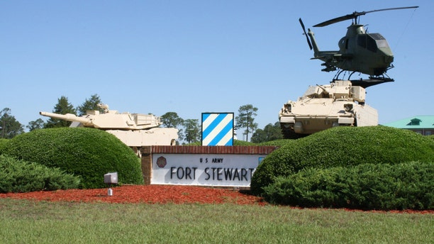 Soldiers were training in darkness when their armored vehicle fell from a bridge and landed upside down in water below, killing three of those inside and injuring three others, the commanding general of Fort Stewart said Monday.