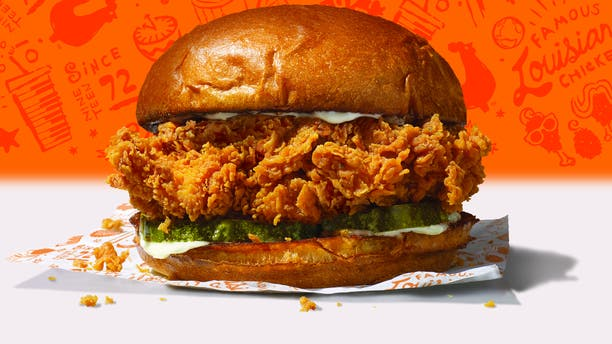 A photo of an inmate who managed to get his hands on the much sought after Popeyes Chicken Sandwich has the internet going wild. (Photo: Popeyes)