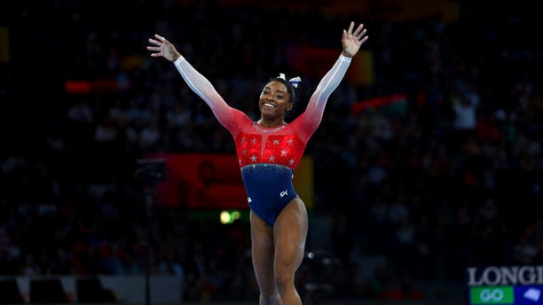 """""""I feel like I never think of records,"""" Biles says of her performances. """"Ijust go out there and do what I came to do, which is compete for the country."""""""