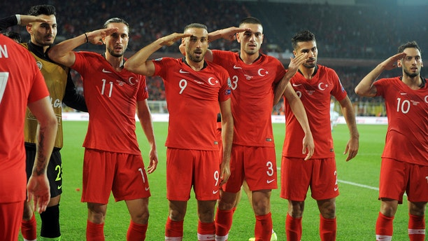 Turkish soccer players gesture as they celebrate their 1-0 win against Albania during a Euro 2020 Group H qualifying soccer match in Istanbul's Ulker Stadium, Friday, Oct. 11, 2019. (AP Photo)