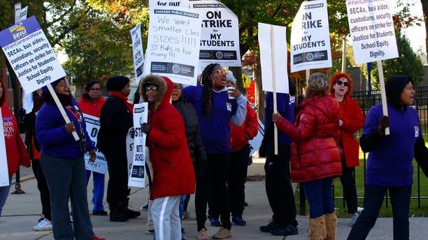 Striking teachers picket outside George Leland Elementary School on Chicago's West Side Thursday, Oct. 17, 2019.