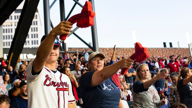 ATLANTA, GA - OCTOBER 9: Fans perform the tomahawk chant during Game Five of the National League Division Series between the Atlanta Braves and the St. Louis Cardinals at SunTrust Park on October 9, 2019 in Atlanta, Georgia. (Photo by Carmen Mandato/Getty Images)