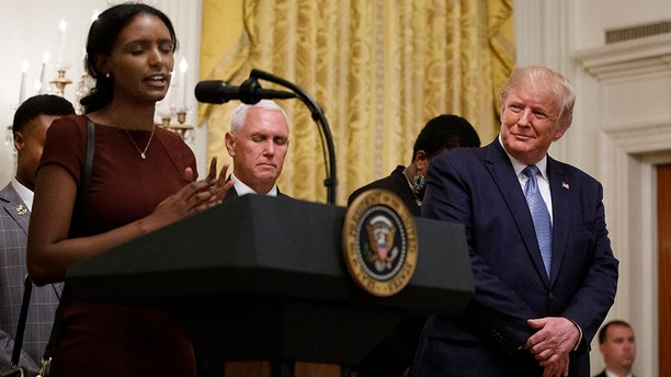 President Donald Trump and Vice President Mike Pence pause on stage during a prayer during the Young Black Leadership Summit at the White House in Washington, Friday, Oct. 4, 2019. (AP Photo/Carolyn Kaster)