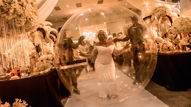 One woman in Nigeria recently shocked guests as she rolled into her tenth wedding anniversary party in a giant, clear, bubble-style balloon.