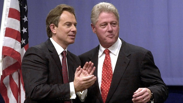 President Bill Clinton British Prime Minister Tony Blair at Warwick University in December 2000. (BRIAN BOULD/AFP/Getty Images, File)