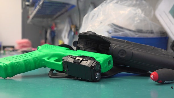 Police departments across the country are starting to use gun cameras, like this one from Viridian Weapons Technologies in Minnesota, as a way to provide an unobstructed view the moment the officer pulls his or her weapon.