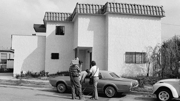 Newsmen examine the car of Dorothy Stratten, Playmate of the year 1980, after the nude bodies of her and her husband, Paul Snider, were found dead in this apartment in Los Angeles Aug. 14, 1980. Police said she was killed with a shotgun blast in the face, and Snider's body was on the floor on top of the gun.
