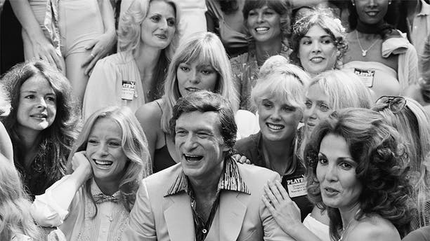 Stratten joins a bevy of Playmates surrounding founder Hugh Hefner at a 1979 party celebrating Playboy's 25th anniversary in Los Angeles.