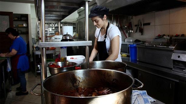 A chep preparing goat dishes on Samothraki.