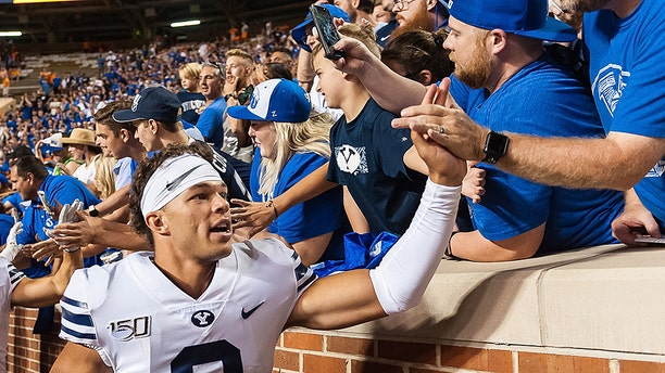 Brigham Young Cougars quarterback Jaren Hall  celebrates with fans after BYU defeated the Tennessee Volunteers 29-26 on September 7, 2019, at Neyland Stadium in Knoxville, Tennessee. (Photo by Bryan Lynn/Icon Sportswire via Getty Images)