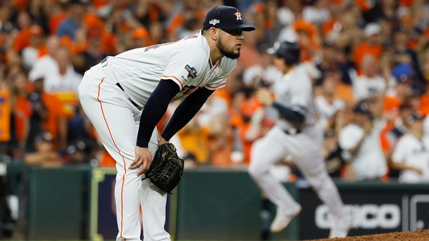 Houston Astros relief pitcher Roberto Osuna reacts after giving up a two-run home run to New York Yankees' DJ LeMahieu during the ninth inning in Game 6 of baseball's American League Championship Series Saturday, Oct. 19, 2019, in Houston. (AP Photo/Matt Slocum)