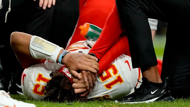Kansas City Chiefs quarterback Patrick Mahomes (15) is helped by trainers after getting injured against the Denver Broncos during the first half of an NFL football game, Thursday, Oct. 17, 2019, in Denver. (AP Photo/Jack Dempsey)
