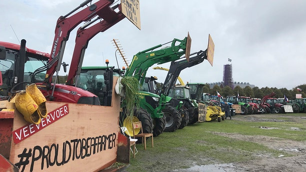 Tractors are lined up during a protest in The Hague, Netherlands, Tuesday, Oct. 1, 2019. (AP Photo/Mike Corder)