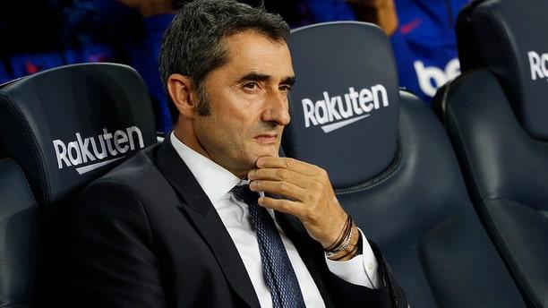 Barcelona head coach Ernesto Valverde sits prior Spanish La Liga soccer match between Barcelona and Sevilla at the Camp Nou stadium in Barcelona, Sunday, Oct. 6, 2019. Barcelona won 4-0. (AP Photo/Joan Monfort)