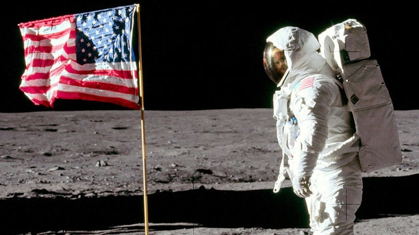 The only clear picture showing of Buzz Aldrin while walking on the Moon has been uncovered by an amateur photographer. Applying photo-enhancing technology used by astronomers to improve the resolution of far-away planets, Andy Saunders was able to alter the photo's clarity. (Credit: SWNS)