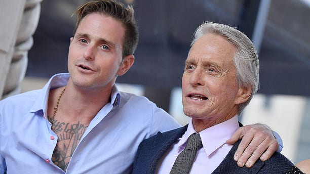 Cameron Douglas and Michael Douglas attending the ceremony honoring Michael Douglas with a star on the Hollywood Walk of Fame on Nov. 6, 2018, in Hollywood. Cameron reflected on his Hollywood upbringing in a memoir being released in October 2019.