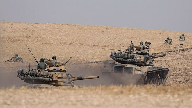Turkish tanks and troops more near Syrian town of Manbij, Syria, on Tuesday, October 15, 2019. (AP/DHA)