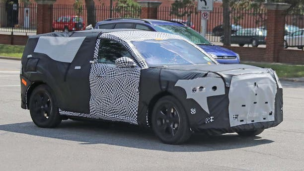 This disguised prototype near Ford's development center is suspected to be the electric SUV.