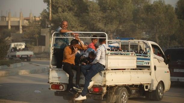 Kurdish Syrians fleeing Wednesday afternoon