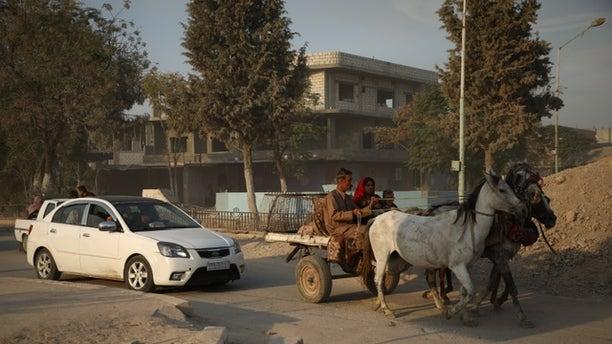 Kurdish Syrians fleeing as Turkish incursion begins